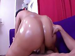 Short haired brunette shows off her oiled bubble butt